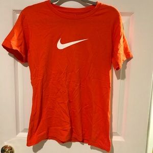 Nike Orange Shirt with White Swoosh Logo